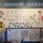 The Minnow Bucket, Huntley, MT features tackle as well as bait. Some equipment is shown, along with maps available for purchase.